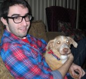 Blogger Jon Clark holding a dog