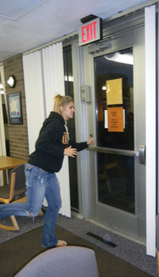 Student runs through an emergency exit.