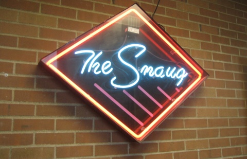 The neon Smaug sign